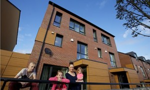 Justine Hutton and her children at their passive house in Oldham